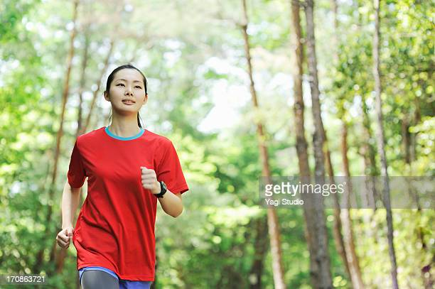 Young woman walking exercise in nature