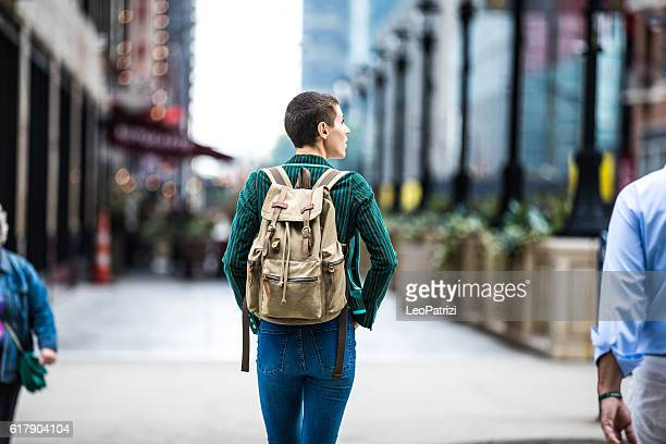 young woman walking for shopping in downtown chicago - chicago illinois stock pictures, royalty-free photos & images