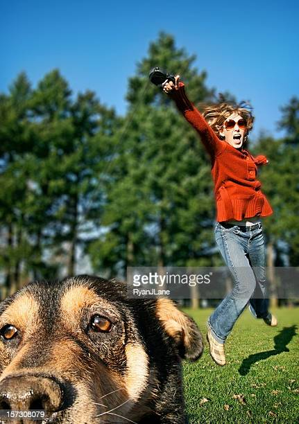 young woman walking her crazy dog - copulation of humans stock photos and pictures