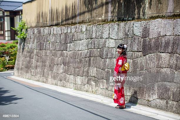Young woman walking in a old street with Kimono,Kyoto