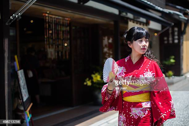 Young woman walking in a old street with Kimono,Kyoto,Japan