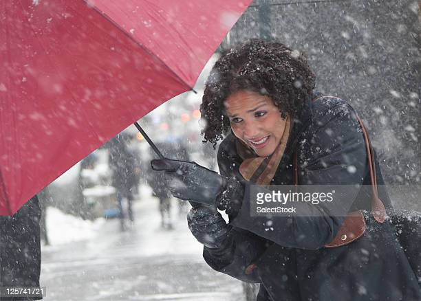 Young woman walking in a snow storm