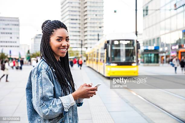 Young woman walking in Berlin - Alexanderplatz