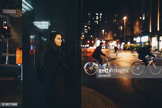 Young woman walking in Berlin at night