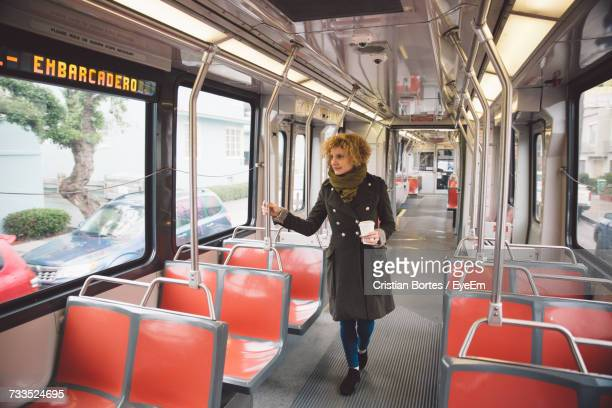 young woman walking in bus - bortes stock pictures, royalty-free photos & images