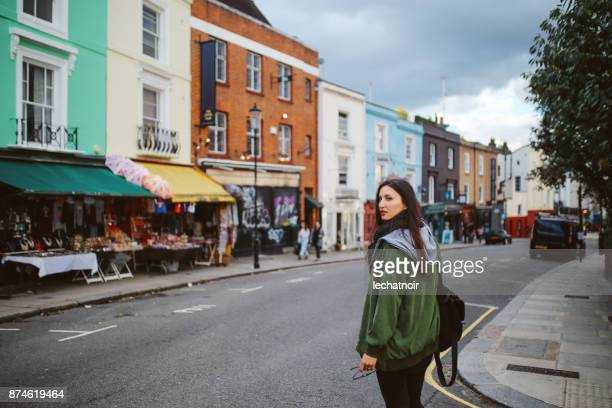 Young woman walking in central London, near Notting Hill