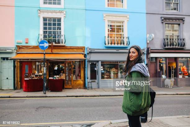 young woman walking in central london, near notting hill - notting hill stock pictures, royalty-free photos & images
