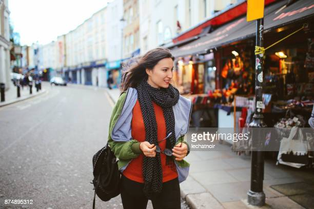 young woman walking in central london, notting hill - chelsea stock pictures, royalty-free photos & images