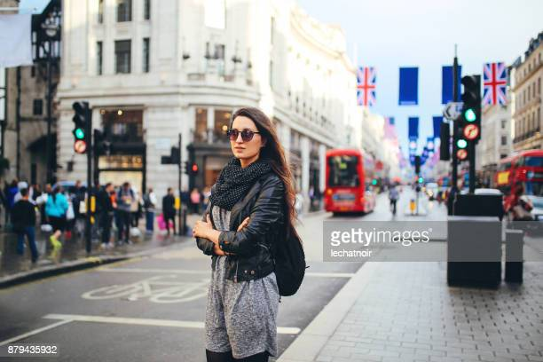 young woman walking in central london - oxford street london stock pictures, royalty-free photos & images
