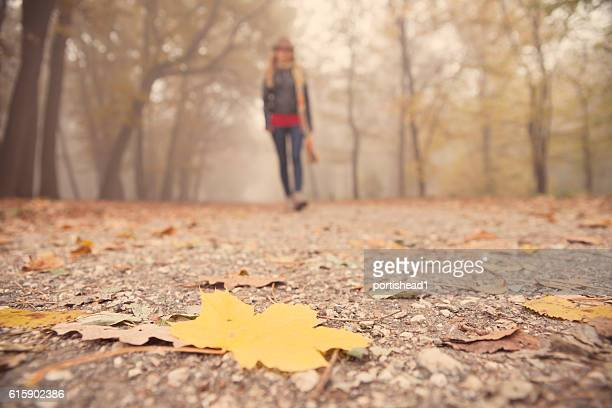 Young woman walking in foggy park