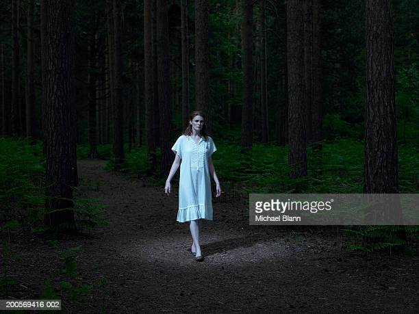 young woman walking in forest - women in slips stock pictures, royalty-free photos & images