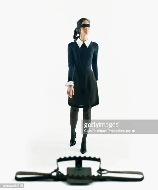 Young woman walking in front of a snare