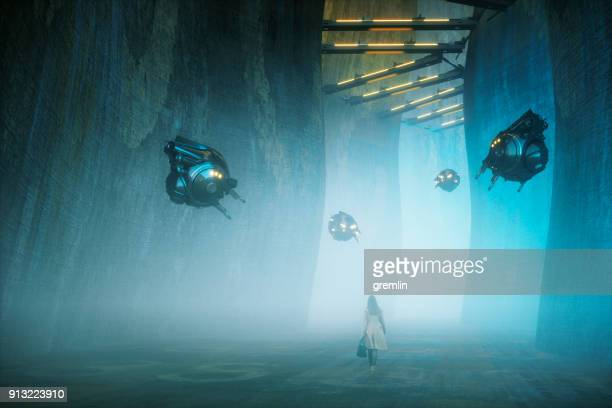 young woman walking in futuristic urban environment - 1984 stock pictures, royalty-free photos & images