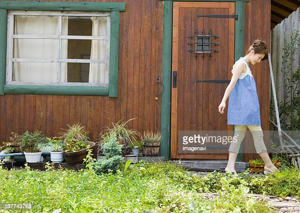 Young woman walking in garden