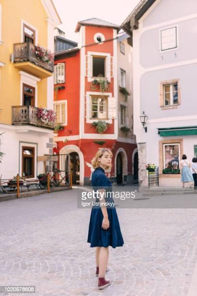 young woman walking in hallstatt - hallstatt stock-fotos und bilder