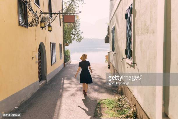 Young woman walking in Hallstatt