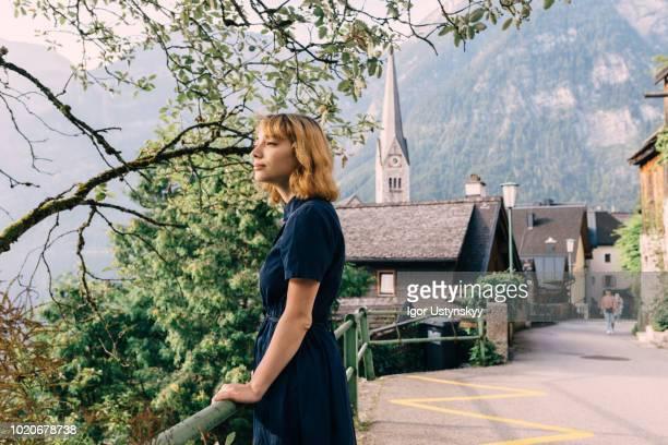 young woman walking in hallstatt - dorf stock-fotos und bilder