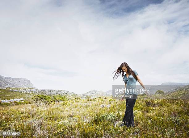 Young woman walking in meadow