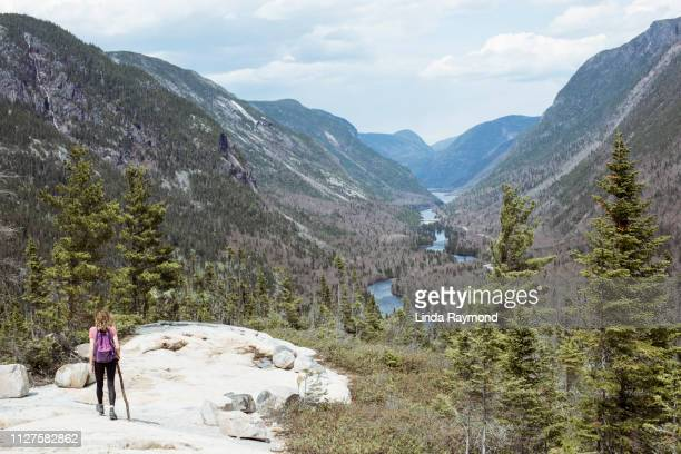 young woman walking in national park des hautes-gorges-de-la-rivière-malbaie, quebec - national park stock pictures, royalty-free photos & images