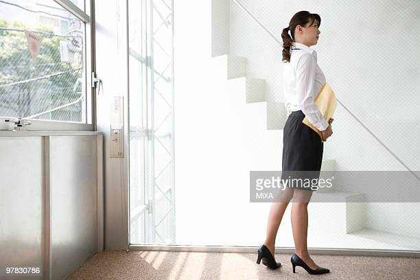 Young woman walking in office