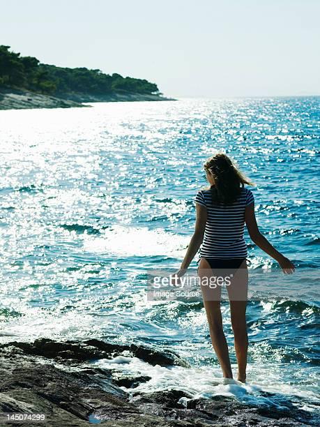 Young woman walking in sea, Dubrovnik, Croatia