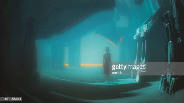 young woman walking in spooky futuristic street - ominous stock pictures, royalty-free photos & images