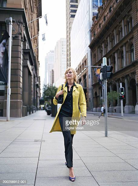 Young woman walking in street