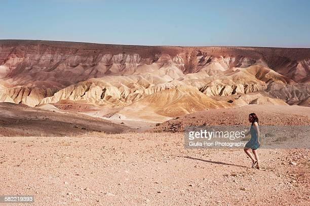 young woman walking in the negev desert - israel stock pictures, royalty-free photos & images