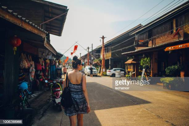 young woman walking in the old town of the koh lanta island, thailand - street market stock pictures, royalty-free photos & images