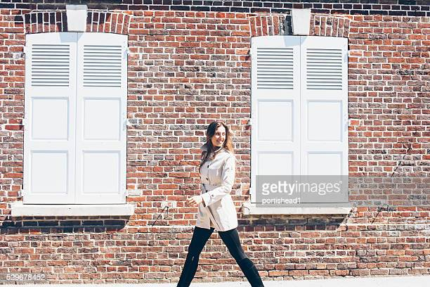 Young woman walking on street