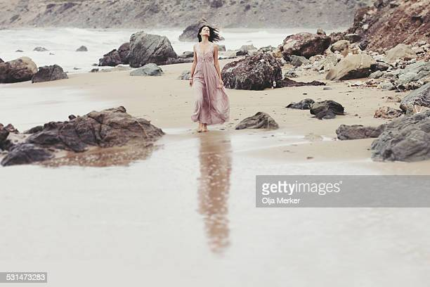 young woman walking on the beach - long dress stock pictures, royalty-free photos & images
