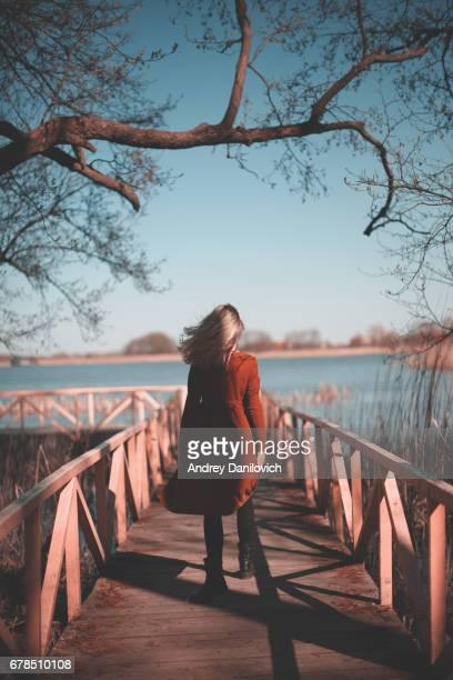 Young woman walking on the bridge