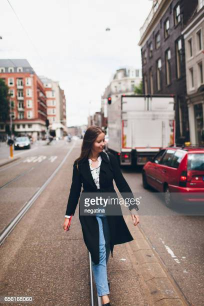 young woman walking on the street in Amsterdam, Netherlands