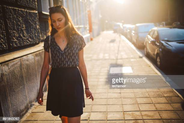 Young woman walking on the street on a sunny day
