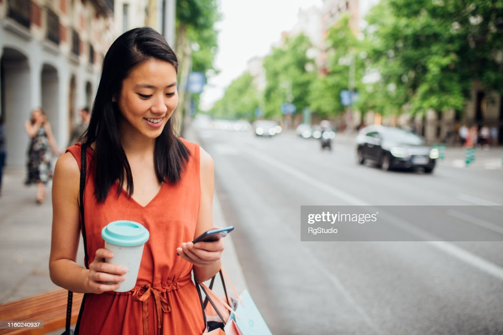 Young woman walking on the street : Stock Photo