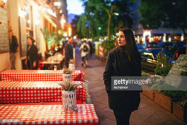 young woman walking on the streets of berlin at night - central berlin stock photos and pictures