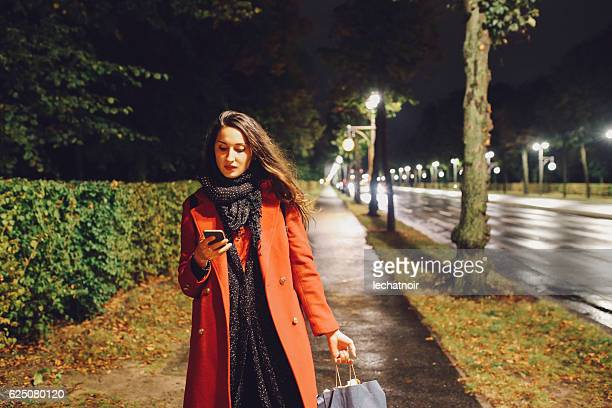 Young woman walking on the streets of Berlin at night