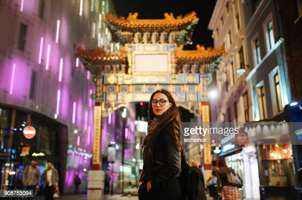 Young woman walking on the streets of London Chinatown district