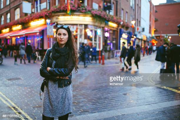 young woman walking on the streets of london - pedestrian zone stock pictures, royalty-free photos & images