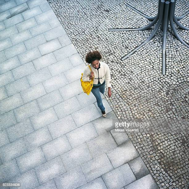 young woman walking outdoors - pavement stock pictures, royalty-free photos & images