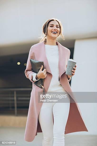 Young woman walking outdoors