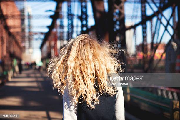 Young woman walking over bridge