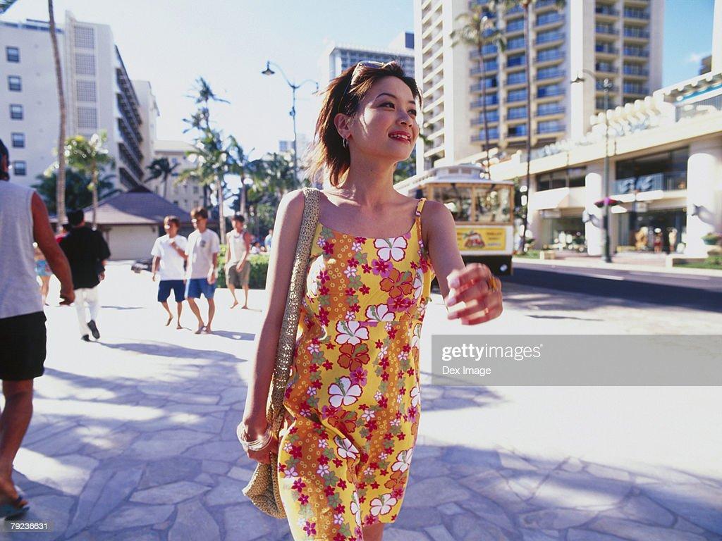 Young woman walking streets of Hawaii : Stock Photo