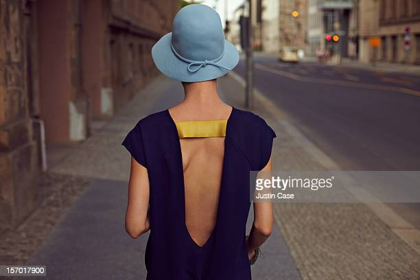 A young woman walking through the city