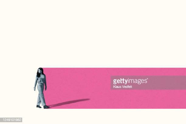 young woman walking towards pink trail - looking over shoulder stock pictures, royalty-free photos & images