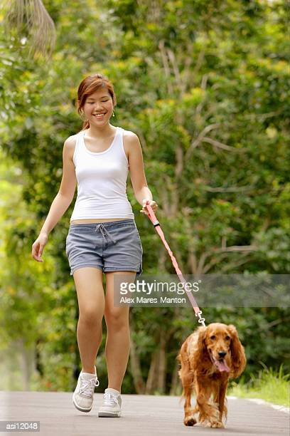 Young woman walking with her dog
