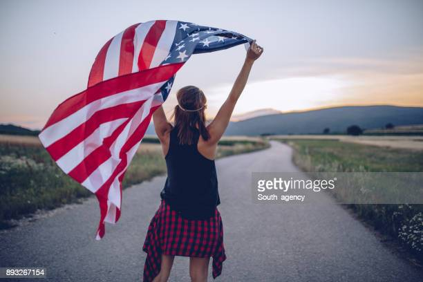 Young woman walking with the flag