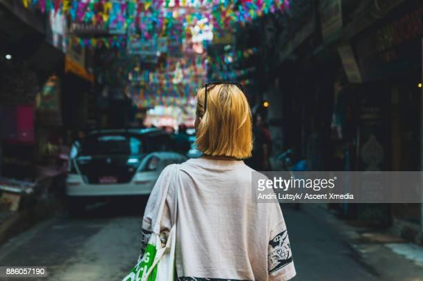 Young woman walks along street market