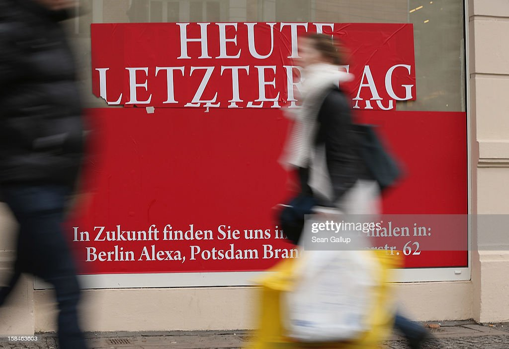 A young woman walks by a window display that reads: 'Today Last Day' on a busy shopping street in Steglitz district on December 17, 2012 in Berlin, Germany. Retailers are hoping for a strong Christmas season in Germany, one of the few countries whose economy has so far weathered the current Eurozone debt crisis relatively well.