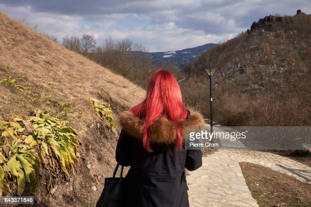A young woman walks in the fortress of Zvecan renovated with funding from the European Union on February 20 2017 in Zvecan Kosovo The new US Trump...